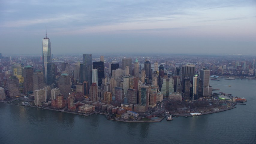 5K stock footage aerial video of Battery Park and Lower Manhattan skyscrapers in New York City, winter, twilight Aerial Stock Footage | AX65_0213
