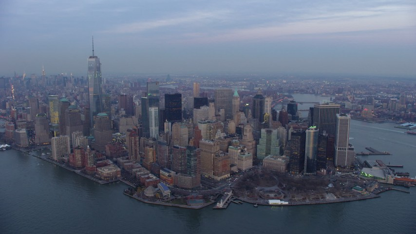 5K stock footage aerial video of flying by Battery Park and Lower Manhattan skyscrapers in New York City, winter, twilight Aerial Stock Footage | AX65_0214