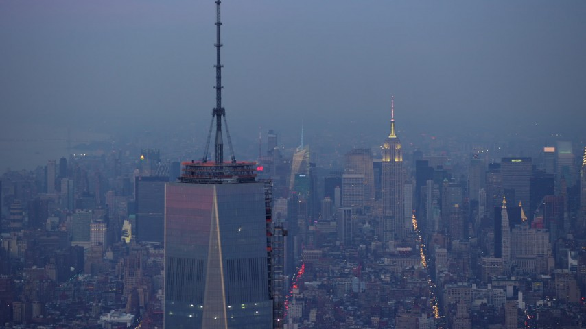 5K stock footage aerial video track top of One World Trade Center in Lower Manhattan with Empire State Building in background, New York City, winter, twilight Aerial Stock Footage   AX65_0216