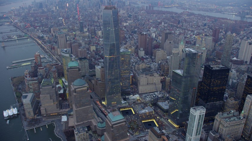 5K stock footage aerial video of Freedom Tower and World Trade Center Memorial in Lower Manhattan, New York City, winter, twilight Aerial Stock Footage | AX65_0217