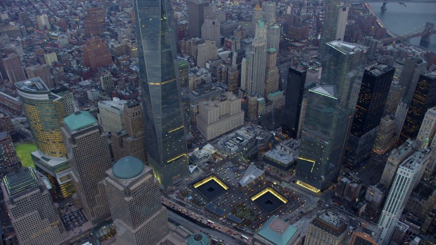 5K stock footage aerial video of bird's eye of World Trade Center Memorial, tilt up to Freedom Tower in Lower Manhattan, New York City, winter, twilight Aerial Stock Footage | AX65_0218