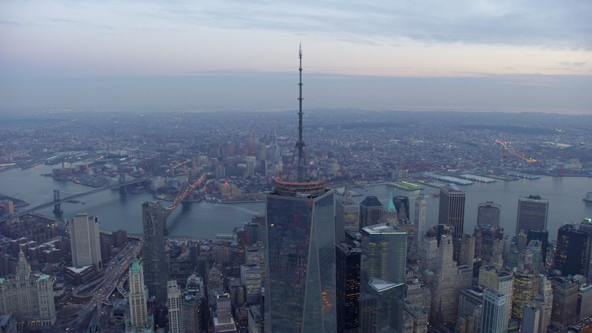 5K stock footage aerial video orbit Freedom Tower in Lower Manhattan, New York City, with East River and Brooklyn in the background, winter, twilight Aerial Stock Footage | AX65_0220
