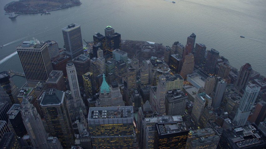 Bird's eye view of downtown skyscrapers and Battery Park in Lower Manhattan, New York City, winter, twilight Aerial Stock Footage | AX65_0223