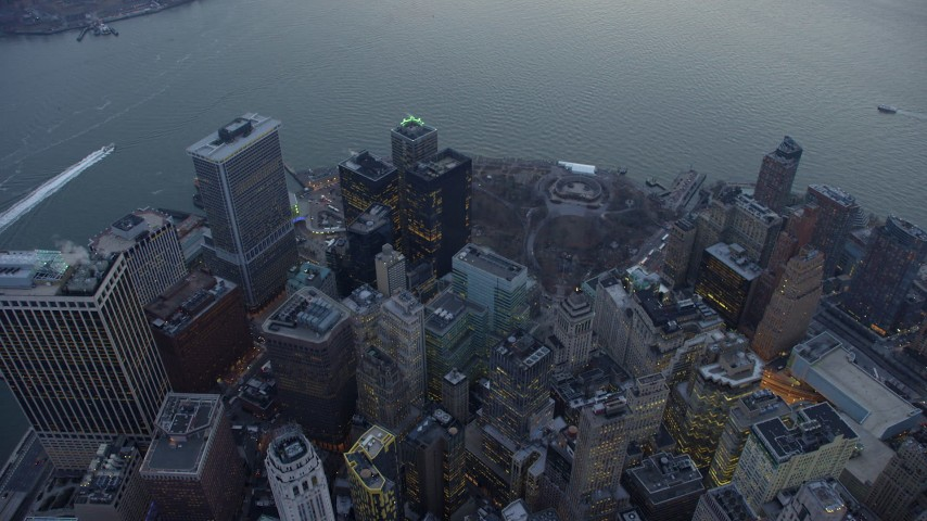 5K stock footage aerial video a bird's eye view of downtown high-rises and Battery Park in Lower Manhattan, New York City, winter, twilight Aerial Stock Footage | AX65_0224