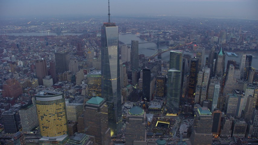 Orbit Freedom Tower and skyscrapers in Lower Manhattan, New York City, winter, twilight Aerial Stock Footage | AX65_0228
