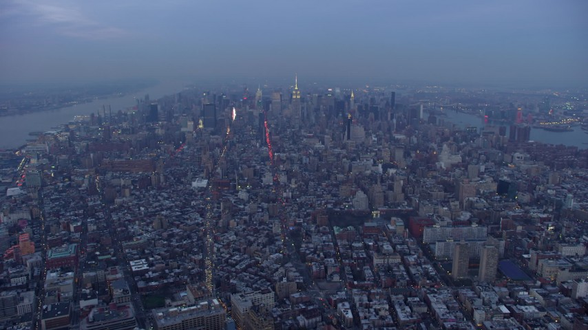 Midtown seen from across Manhattan cityscape, New York City, winter, twilight Aerial Stock Footage | AX65_0230
