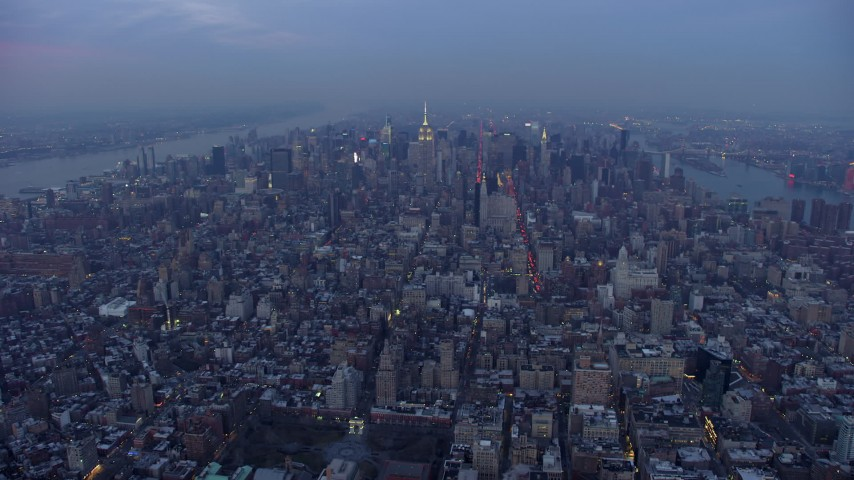 5K stock footage aerial video fly over the Manhattan cityscape to approach Midtown Manhattan, New York City, winter, twilight Aerial Stock Footage | AX65_0232