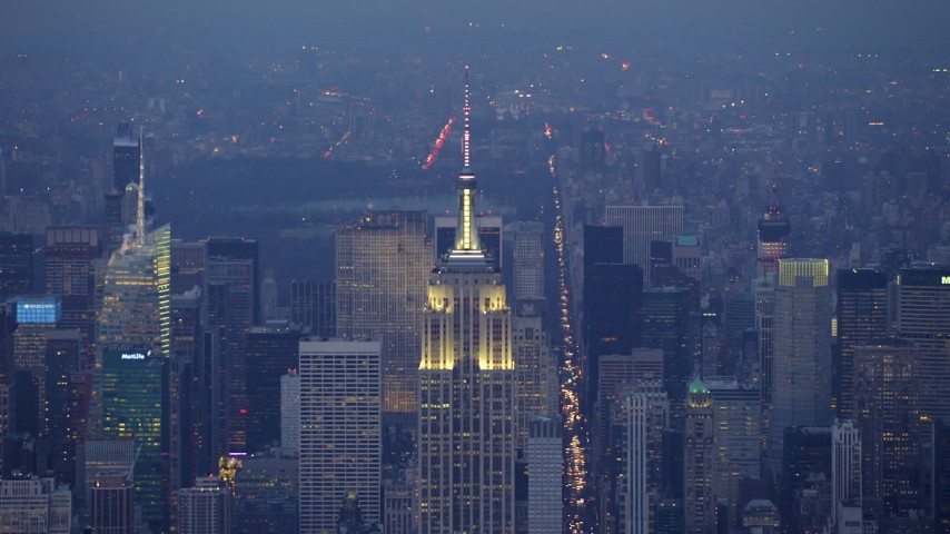 5K stock footage aerial video track and approach top of Empire State Building in Midtown Manhattan, New York City, winter, twilight Aerial Stock Footage | AX65_0233