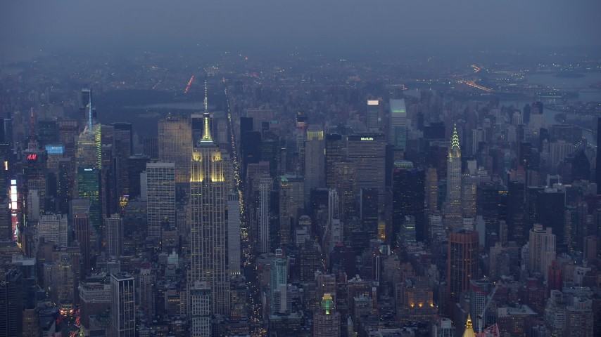 5K stock footage aerial video approach top of Empire State Building in Midtown Manhattan, New York City, winter, twilight Aerial Stock Footage | AX65_0234