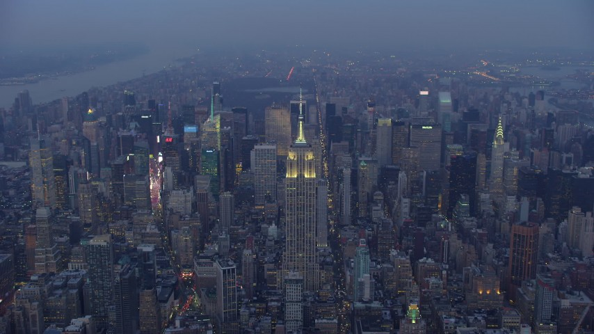 5K stock footage aerial video approach the Empire State Building in Midtown Manhattan, New York City, winter, twilight Aerial Stock Footage   AX65_0235