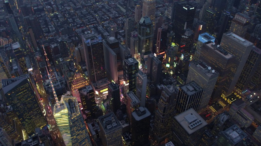 5K stock footage aerial video flyby skyscrapers around the lights of Times Square in Midtown Manhattan, New York City, winter, twilight Aerial Stock Footage | AX65_0237