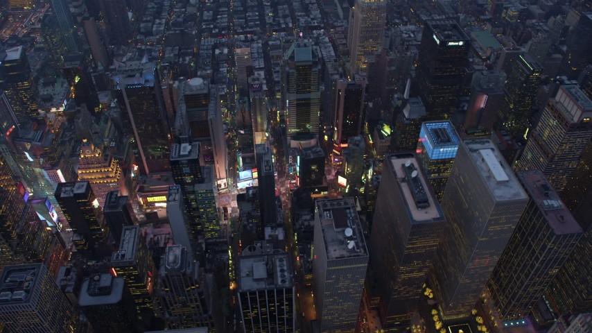 5K stock footage aerial video of lights of Times Square and skyscrapers in Midtown Manhattan, New York City, winter, twilight Aerial Stock Footage | AX65_0238