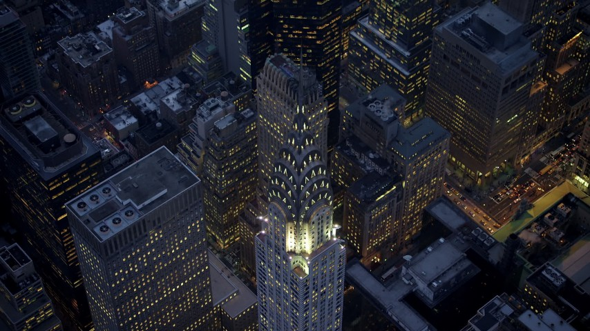5K stock footage aerial video tilt to a bird's eye view of the Chrysler Building in Midtown Manhattan, New York City, winter, twilight Aerial Stock Footage | AX65_0241