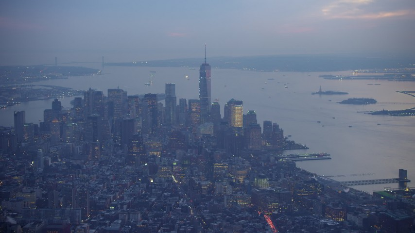 Freedom Tower, Lower Manhattan skyscrapers and New York Harbor, New York City, winter, twilight Aerial Stock Footage | AX65_0242