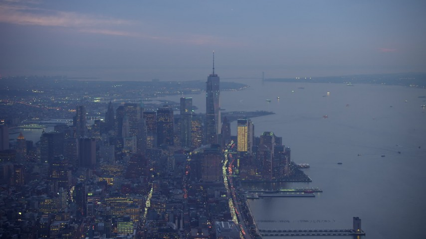 5K stock footage aerial video of One World Trade Center, Lower Manhattan skyscrapers and New York Harbor, New York City, winter, twilight Aerial Stock Footage | AX65_0243
