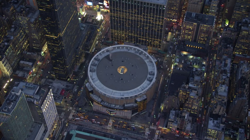 5K stock footage aerial video bird's eye view of Madison Square Garden arena, Midtown Manhattan, New York City, winter, twilight Aerial Stock Footage | AX65_0244