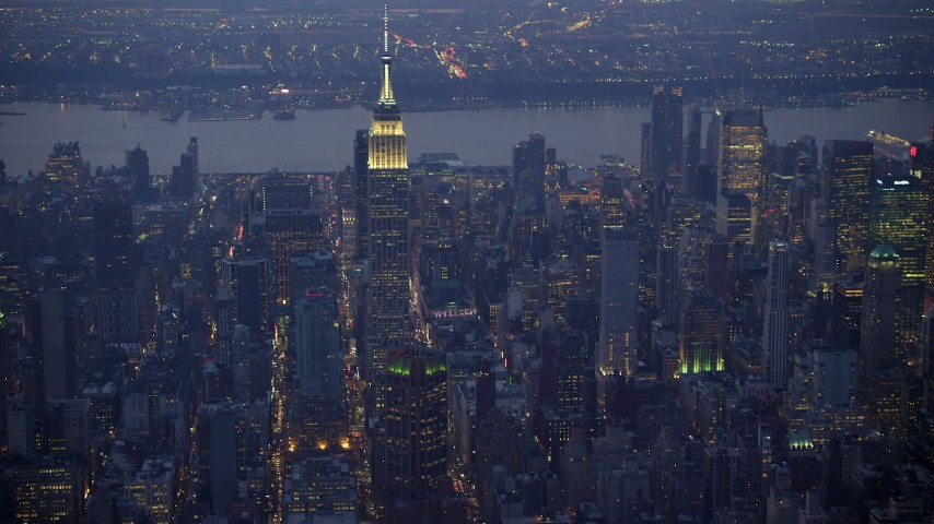 Slow approach to the Empire State Building in Midtown Manhattan, New York City, winter, twilight Aerial Stock Footage | AX65_0249