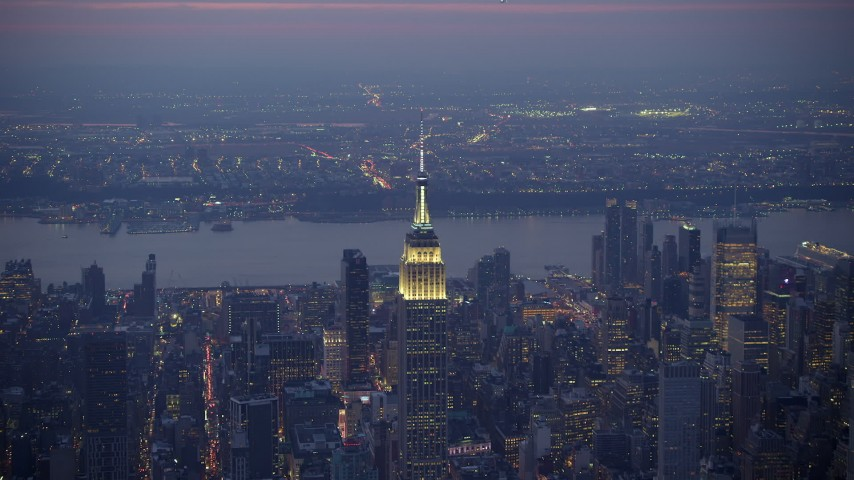 5K stock footage aerial video orbit of the Empire State Building in Midtown Manhattan, New York City, winter, twilight Aerial Stock Footage | AX65_0250