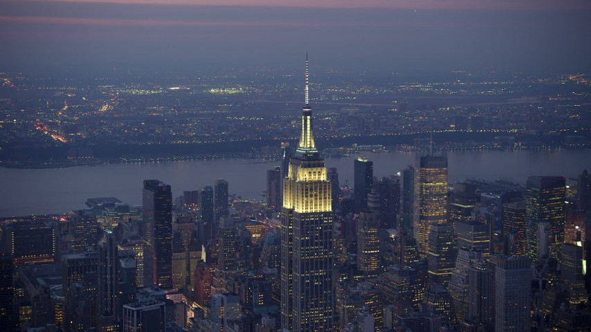 Orbiting the Empire State Building in Midtown Manhattan, New York City, winter, twilight Aerial Stock Footage | AX65_0251