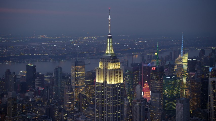 5K stock footage aerial video of an orbit of the Empire State Building in Midtown Manhattan, New York City, winter, twilight Aerial Stock Footage | AX65_0252