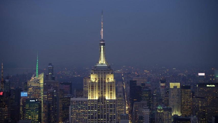 5K stock footage aerial video orbit the Empire State Building in Midtown Manhattan and reveal the Chrysler Building, New York City, winter, twilight Aerial Stock Footage | AX65_0253