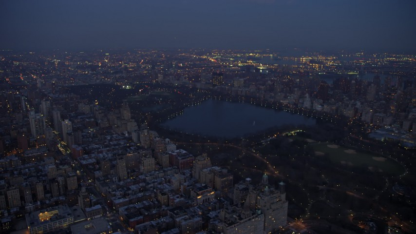 5K stock footage aerial video track the reservoir at Central Park in New York City, winter, night Aerial Stock Footage | AX65_0256
