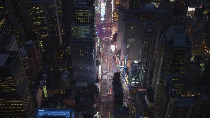 5K stock footage aerial video tilt to a bird's eye view of traffic in Times Square, Midtown Manhattan, New York City, winter, night Aerial Stock Footage | AX65_0258