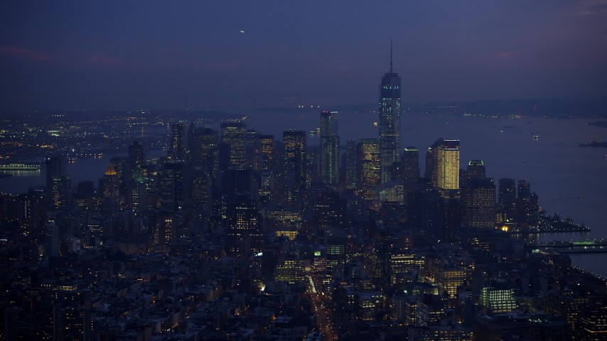 Slow approach to Freedom Tower and Lower Manhattan seen from Midtown Manhattan, New York City, winter, twilight Aerial Stock Footage | AX65_0260