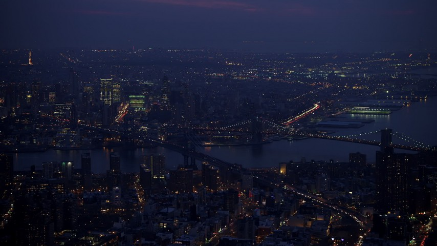 Manhattan and Brooklyn Bridges spanning East River, Brooklyn in the background, New York City, winter, twilight Aerial Stock Footage | AX65_0262