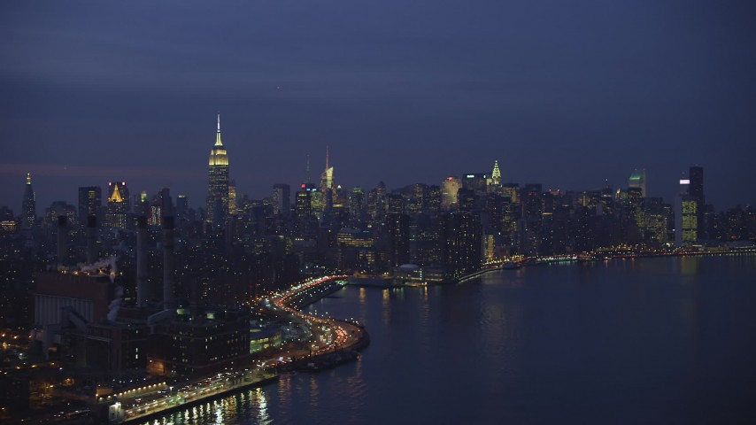 5K stock footage aerial video of Empire State Building and the Midtown Manhattan skyline, New York City, winter, night Aerial Stock Footage | AX65_0266