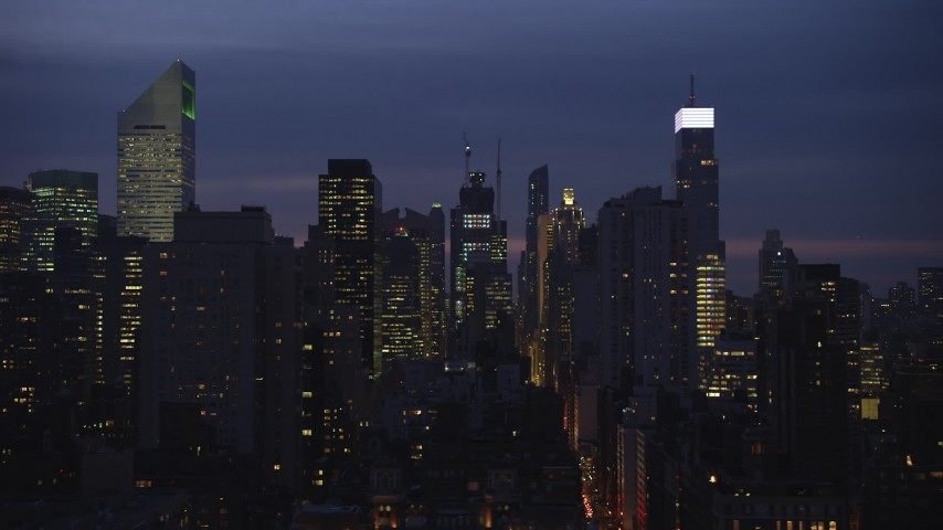 5K stock footage aerial video of busy streets and skyscrapers in Midtown Manhattan, New York City, winter, night Aerial Stock Footage | AX65_0276