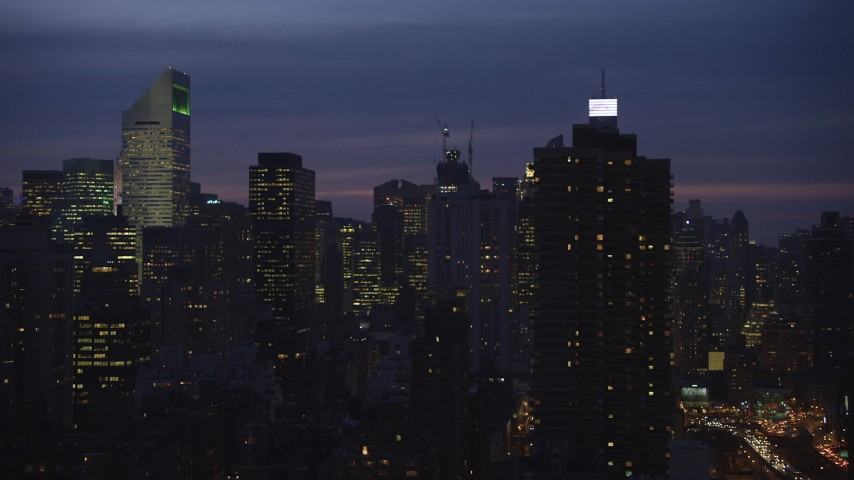 5K stock footage aerial video flyby Midtown Manhattan skyscrapers near Citigroup Center in New York City, winter, night Aerial Stock Footage | AX65_0277