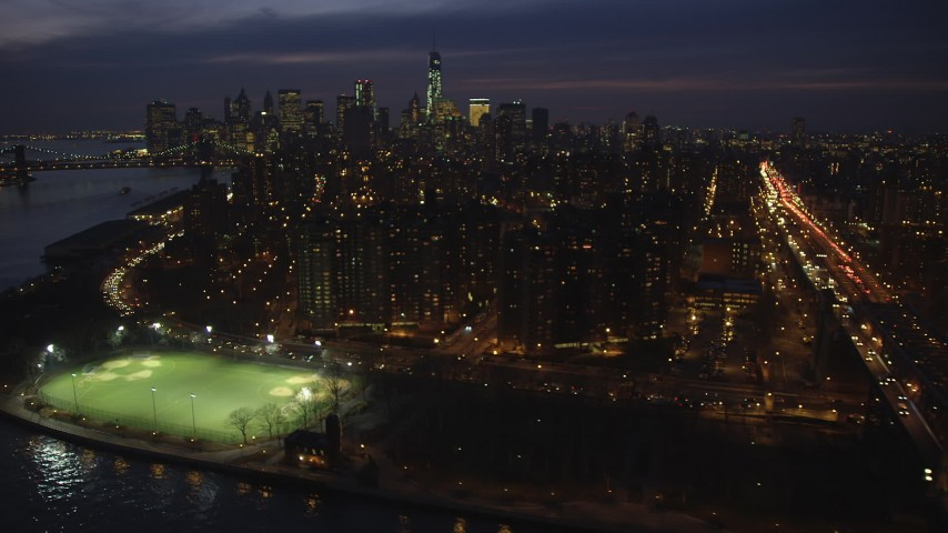 5K stock footage aerial video flyby public housing, and FDR Drive on Lower East Side, with Lower Manhattan skyline in the background, NYC, winter, night Aerial Stock Footage | AX65_0281
