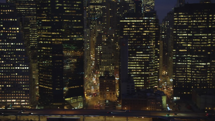 Flyby FDR Drive and tall skyscrapers in Lower Manhattan, New York City, winter, night Aerial Stock Footage | AX65_0283