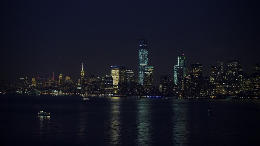 5K stock footage aerial video of the skyline of Lower Manhattan and Freedom Tower, New York City, winter, night Aerial Stock Footage | AX65_0288