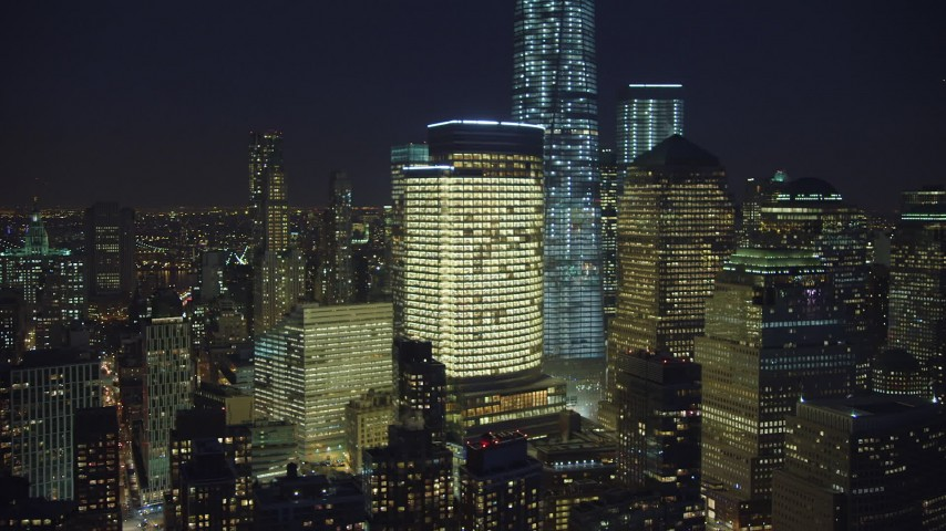 Flying by World Trade Center skyscrapers and Freedom Tower in Lower Manhattan, New York City, winter, night Aerial Stock Footage | AX65_0291