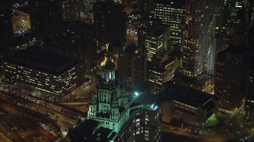 5K stock footage aerial video track the top the Manhattan Municipal Building in Lower Manhattan, New York City, winter, night Aerial Stock Footage | AX65_0292