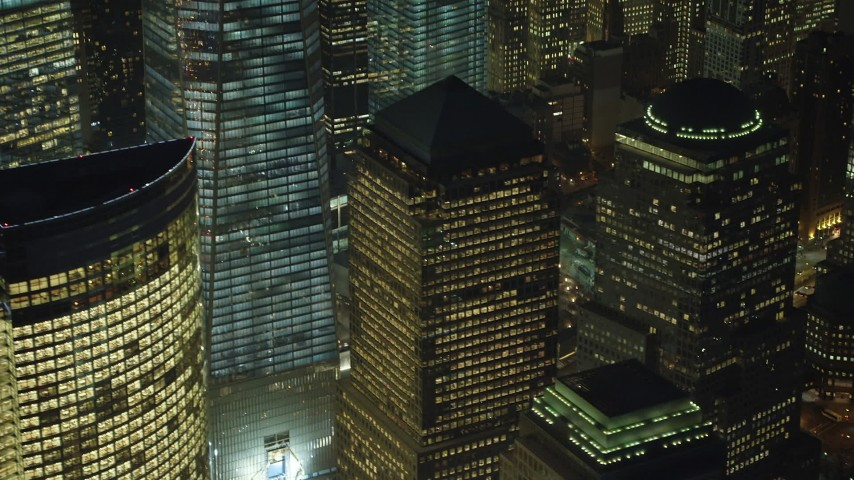5K stock footage aerial video orbit and tilt up the side of One World Trade Center skyscraper in Lower Manhattan, New York City, winter, night Aerial Stock Footage | AX65_0297