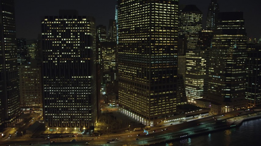 5K stock footage aerial video flyby tall riverfront skyscrapers in Lower Manhattan, New York City, winter, night Aerial Stock Footage | AX65_0300
