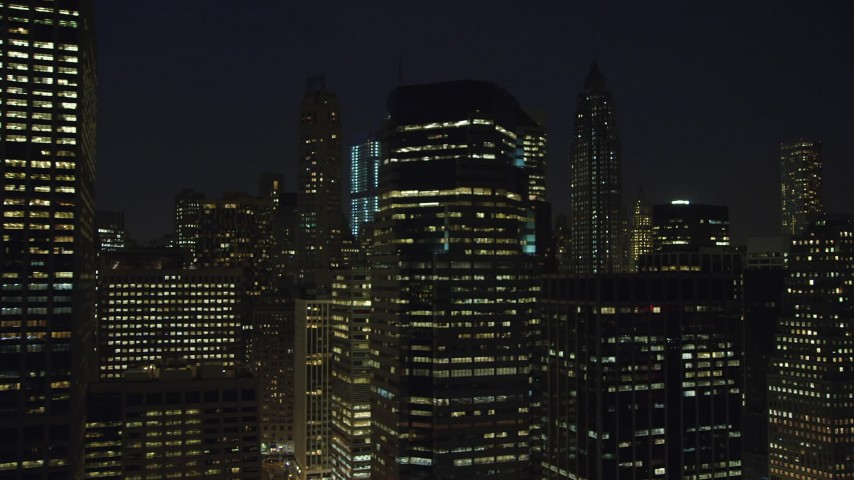 5K stock footage aerial video of flying by tall riverfront skyscrapers in Lower Manhattan, New York City, winter, night Aerial Stock Footage | AX65_0301