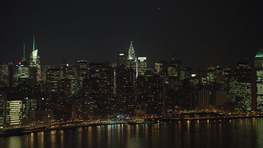 5K stock footage aerial video approach the Chrysler Building and Midtown Manhattan skyscrapers, New York City, winter, night Aerial Stock Footage | AX65_0305