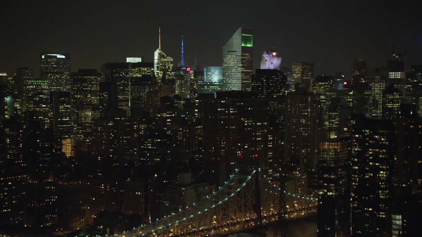 5K stock footage aerial video of Citigroup Center Midtown Manhattan skyscrapers, New York City, winter, night Aerial Stock Footage | AX65_0313