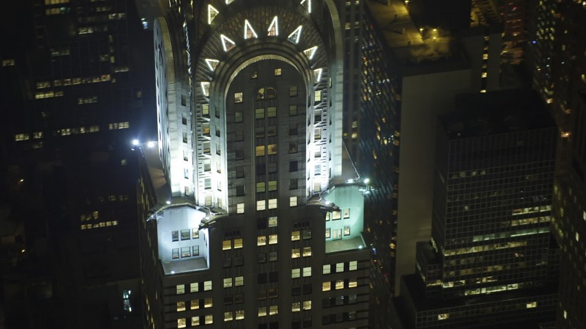 5K stock footage aerial video of an orbit of the Chrysler Building in Midtown Manhattan, New York City, winter, night Aerial Stock Footage | AX65_0318