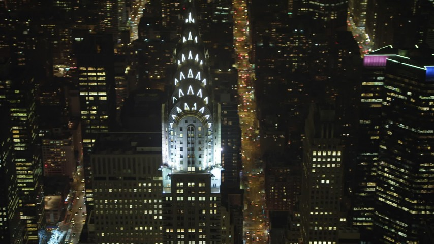 An orbit around the top of the Chrysler Building in Midtown Manhattan, New York City, winter, night Aerial Stock Footage | AX65_0319