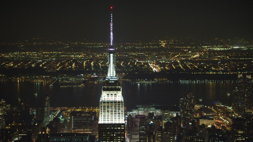 5K stock footage aerial video orbit top of the Empire State Building in Midtown Manhattan, New York City, winter, night Aerial Stock Footage | AX65_0322