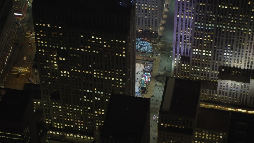 5K stock footage aerial video orbit Rockefeller Center skyscraper, Midtown Manhattan, New York City, winter, night Aerial Stock Footage | AX65_0334