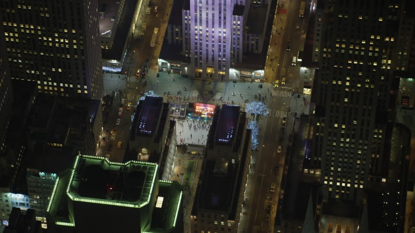 Orbit the Rockefeller Center ice skating rink, Midtown Manhattan, New York City, winter, night Aerial Stock Footage | AX65_0336