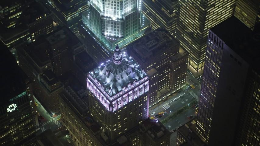 An orbit of the Helmsley Building in Midtown Manhattan, New York City, winter, night Aerial Stock Footage | AX65_0342
