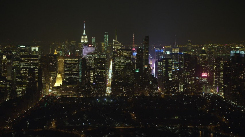 5K stock footage aerial video of Midtown Manhattan seen from Central Park, New York City, winter, night Aerial Stock Footage | AX65_0344