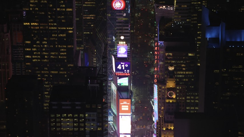 5K stock footage aerial video approach the large screens and 2014 New Years ball at Times Square, New York City, winter, night Aerial Stock Footage | AX65_0346